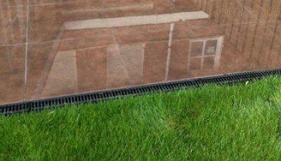 Wateroverlast, afvoerputje in de tuin aanleggen