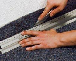 Zelf tapijt leggen, de randen snijden